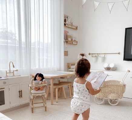 A toddler in a kid's room - best playroom blinds and playroom curtains blog featured image.