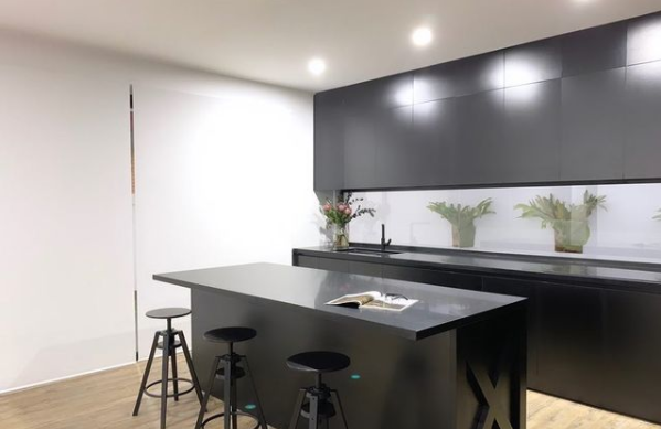 A contemporary kitchen with large kitchen blinds