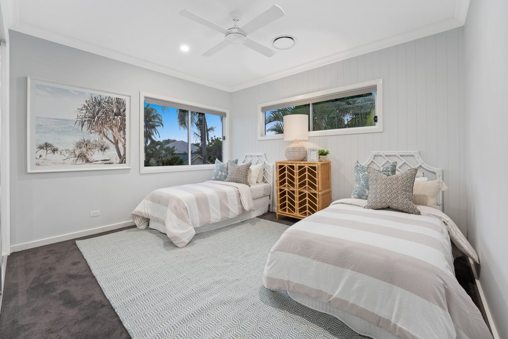 Best blinds for bedroom windows - a contemporary bedroom with two beds and modern blinds in windows