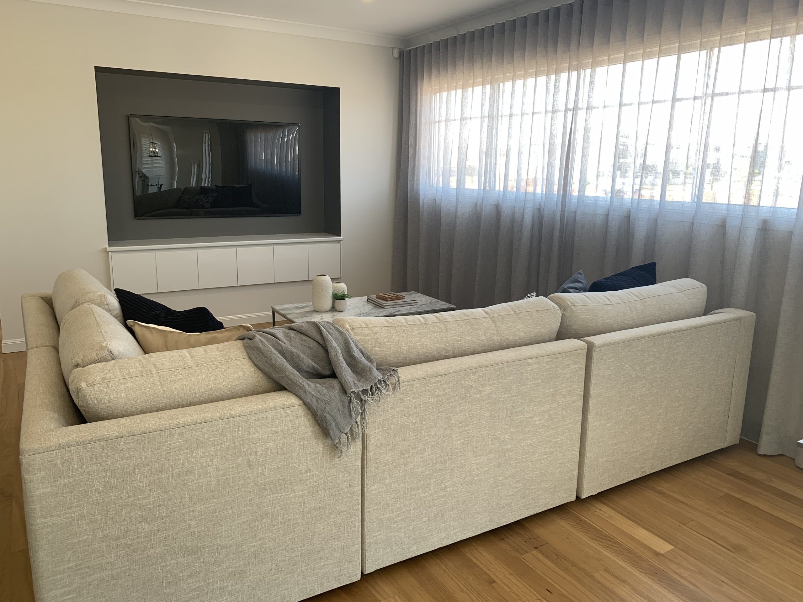 A modern home theatre media room with curtains | Home theatre curtains blog featured image