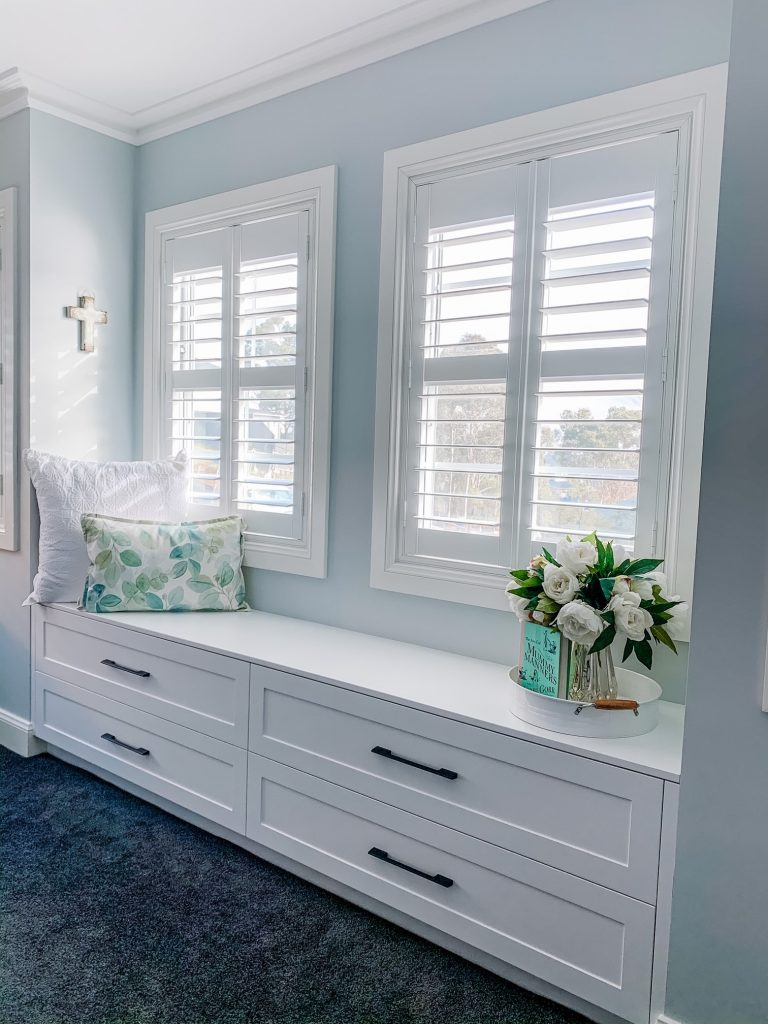 Plantation shutters in a dressing room - how to clean plantation shutters blog featured image