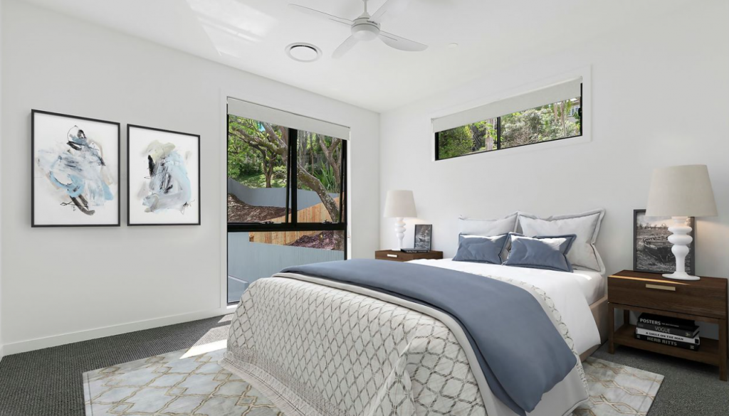 A bedroom with large blinds in the windows - how to clean your blinds blog featured image