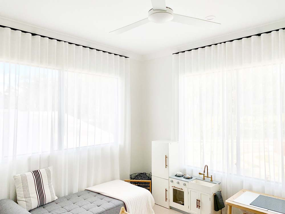 Curtains in a Living Room with a Kitchenette