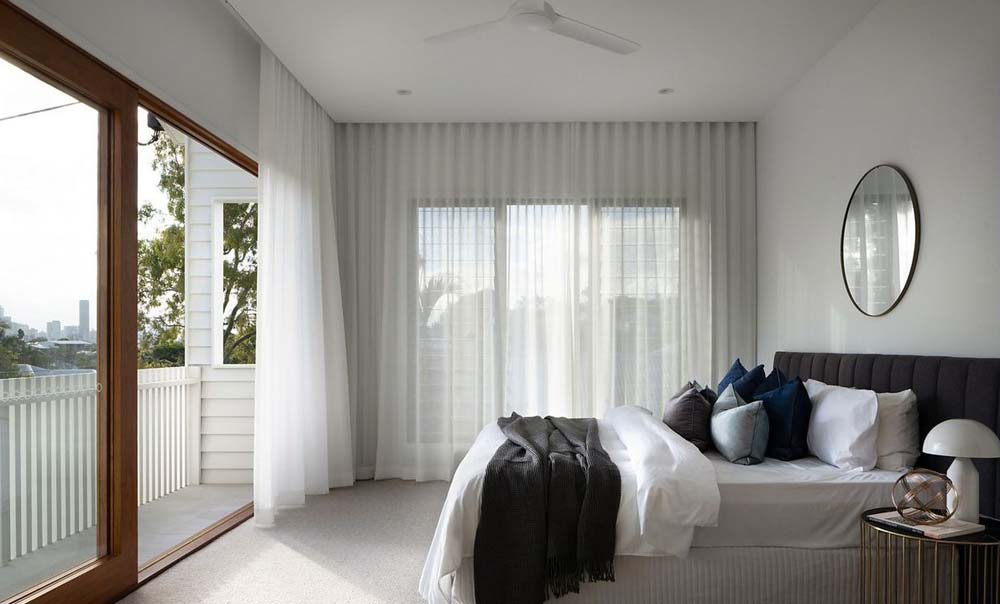 A modern bedroom with elegant curtains
